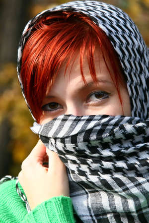 portrait of woman with red hair and scarf like eastern photo