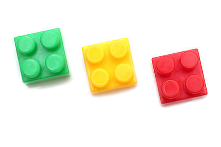 multi age: blocks pieces green yellow and red isolated on white background Stock Photo
