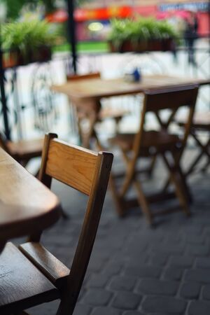porch scene: tables and chairs in the bar.Shallow depth of field
