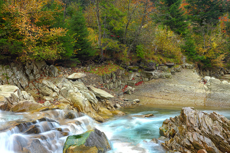 rapids on a rocky mountain river. Autumn time