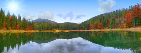 provincial forest parks: picturesque lake in the autumn forest. Mirror reflection
