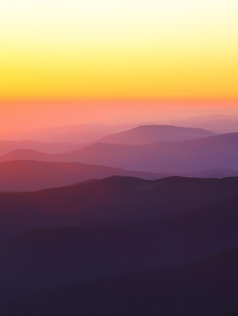 mountain peaks at sunset. sunset haze