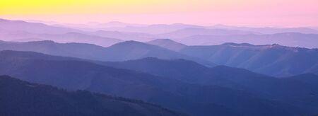 haze: mountain peaks at sunset. sunset haze
