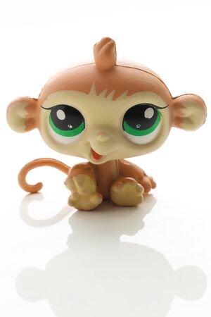 shaddow: cute toy monkey. Isolated on white background with shaddow