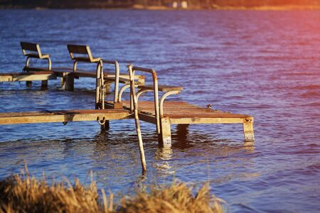 footbridges: empty old footbridges with benches on a lake.