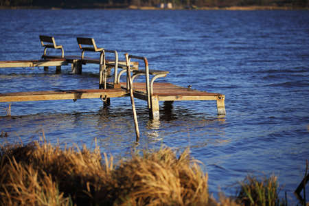footbridges: empty old footbridges with benches on a lake. Daylight