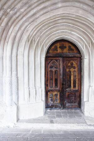 metal door: detail of an old church or castle door. Old wooden door Stock Photo