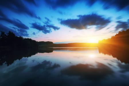 Majestic sunrise over the lake. Long exsposure. Mirror reflection