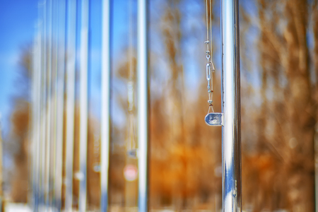 Row of flagpoles without flags. Shallow depth of field Stock Photo