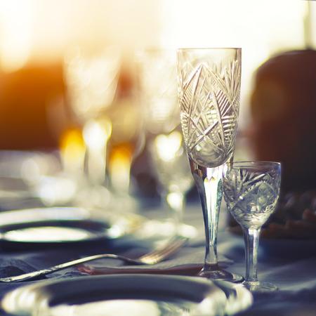 Served dinner table in a restaurant. Restaurant interior. Defocused background Stock Photo