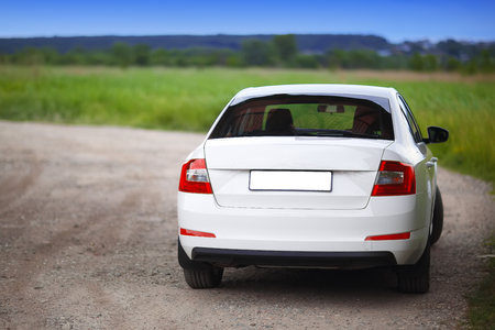 Rear-side view of a car on nature background Stock Photo