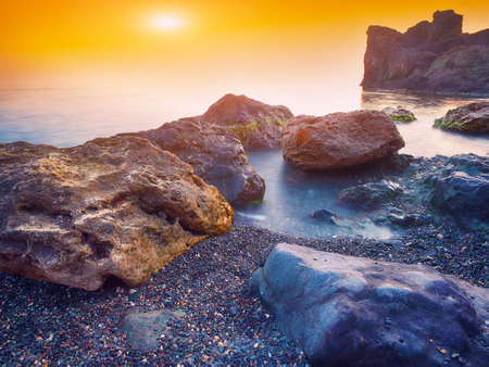 river: Seascape during sunset. Beautiful natural seascape at long exposure. Stones at foreground