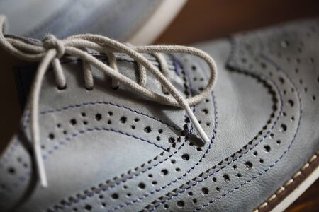 Grey oxford shoes. Close up. Selective focus with shallow DOF