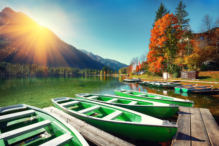 Fantastic autumn day at Hintersee lake. Few boats on the lake with turquoise water of Hintersee lake. Location: resort Ramsau, National park Berchtesgadener Land, Upper Bavaria, Germany Alps, Europe