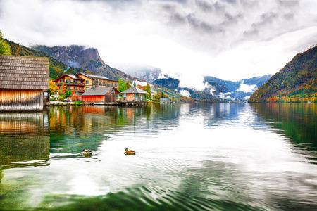 Idyllic autumn scene in Grundlsee lake. Misty morning.Location: resort Grundlsee, Liezen District of Styria, Austria, Alps. Europe. 写真素材