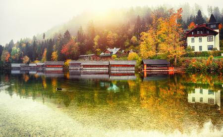 Misty morning on Altaussee village.Misty autumn scene in the morning. Mirror reflection. Location: resort village Altaussee, Liezen District of Styria, Austria, Alps. Europe.
