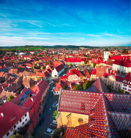 View from bell tower of St Mary Cathedral on the Old Town in Sibiu city. Aerial cityscape of Sibiu town. Impressive morning scene of Transylvania, Romania, Europe
