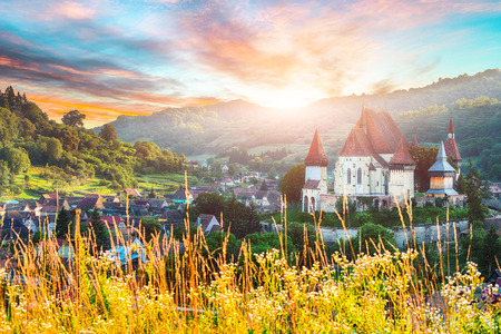 Beautiful medieval architecture of Biertan fortified Saxon church in Romania. Amazing sunset in Biertan.Transylvania, Sibiu, Biertan, Romania, Europe.