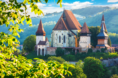 Beautiful medieval architecture of Biertan fortified Saxon church in Romania. Amazing sunset in Biertan.Transylvania, Sibiu, Biertan, Romania, Europe. Reklamní fotografie