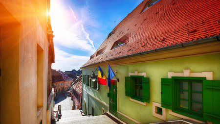 Historical old buildings in the medieval city Sibiu- Hermannstadt, Romania. Eyes in the roof - architectural detail The Romania Eyes 写真素材