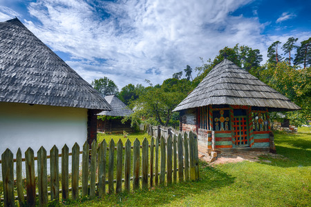 Fantastic summer scene in Transylvania. View of traditional romanian peasant houses. Beauty of countryside rural scene of Transylvania, Romania, Europe.