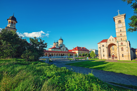 The Coronation Orthodox Cathedral and Roman Catholic cathedral in Fortress of Alba Iulia. Dramatic   summer scene of Transylvania, Alba Iulia city, Romania, Europe
