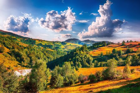 Majestic countryside landscape with forested hills and grassy meadows in mountains. Picturesque views near romanian village Rogojel of Cluj County, Romania, Europe 스톡 콘텐츠