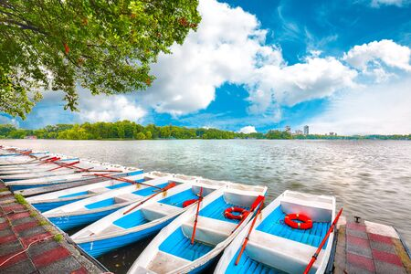 Boats in Public Garden Herastrau (King Mihai I of Romania Park). Fantastic sunny morning on the pond. Bucharest, Romania, Europe