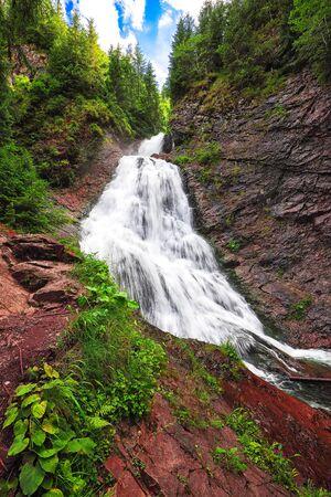 View of Bride's Veil / Valul Miresei Waterfall. Dramatic scene in Apuseni Natural Park, Cluj County, Transylvania, Romania, Europe.