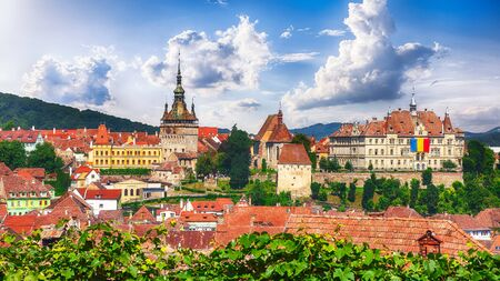 Panoramic summer view over the medieval cityscape architecture in Sighisoara town, historical region of Transylvania, Romania, Europe Foto de archivo - 150119511