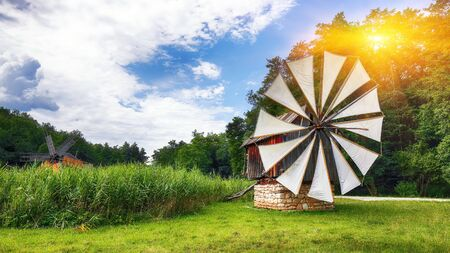 Amazing summer view of traditional romanian windmill. Fantastic rural scene of Transylvania, Romania, Europe. Stockfoto
