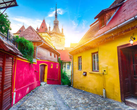 Stunning summer view of medieval city Sighisoara city and Clock Tower built by Saxons, Transylvania, Romania, Europe