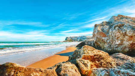 Picturesque Peschici with wide sandy beach in Puglia, adriatic coast of Italy. Location Peschici, Gargano peninsula, Apulia, southern Italy, Europe. Stock Photo