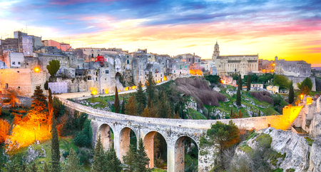 Gravina in Puglia ancient town, bridge and canyon at sunrise. Panoramic view of old city Gravina in Puglia, Apulia, Italy. Europe Reklamní fotografie