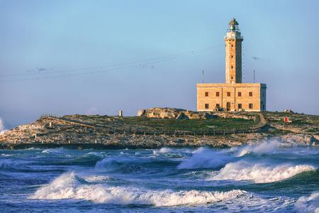 The Lighthouse of Vieste, rises on the isle of Santa Eufemia. Lighthouse In Vieste, Gargano Peninsula, Apulia region, Italy, Europe