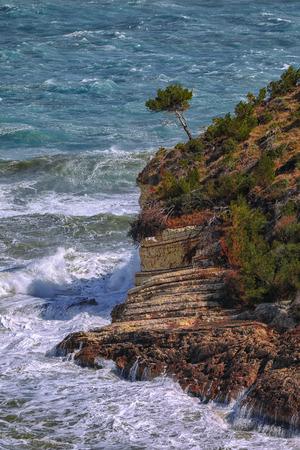 Above the cliffs at the coastline of Vieste. Summer rocky sea coast near Architello (Arch) of San Felice on the Gargano peninsula, Puglia, Italy Reklamní fotografie