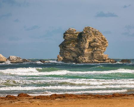 Gattarella islet or Portonuovo rock. Gargano coast: Portonuovo beach,Vieste,Apulia, Italy Reklamní fotografie