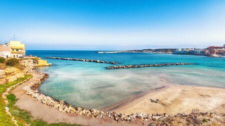 Otranto - coastal town in Puglia with turquoise sea. Italian vacation. Town Otranto, province of Lecce in the Salento peninsula, Puglia, Italy Foto de archivo - 134180911