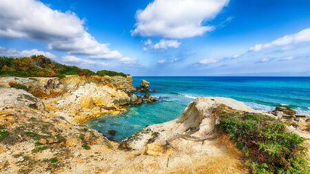 Picturesque seascape with white rocky cliffs, sea bay, islets and faraglioni near by Conca Specchiulla Beach, Salento Adriatic sea coast, Puglia, Italy Foto de archivo - 134180980