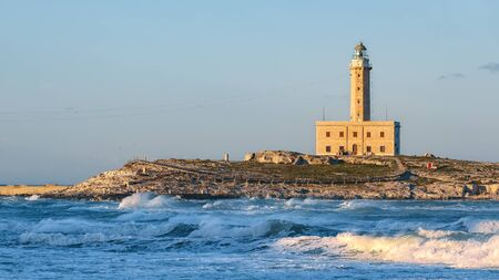 The Lighthouse of Vieste, rises on the isle of Santa Eufemia. Lighthouse In Vieste, Gargano Peninsula, Apulia region, Italy, Europe Foto de archivo - 134181336