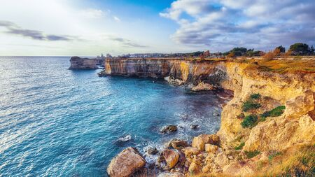 Picturesque seascape with cliffs rocky arch and stacks (faraglioni) at Torre Sant Andrea, Salento coast, Puglia region, Italy Foto de archivo - 134182194