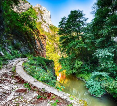 Turda gorge Cheile Turzii is a natural reserve with marked trails for hikes on Hasdate River situated near Turda close to Cluj-Napoca, in Transylvania, Romania, Europe. Inside canyon
