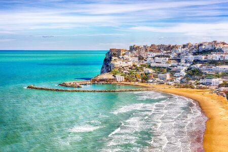 Picturesque Peschici with wide sandy beach in Puglia, adriatic coast of Italy. Location Peschici, Gargano peninsula, Apulia, southern Italy, Europe. Stok Fotoğraf