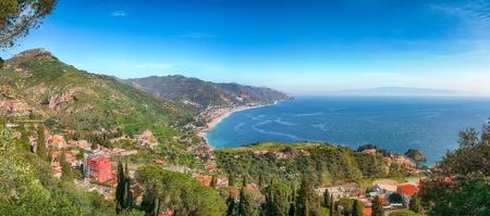 Ionian sea and beautiful mountains landscape in bright summer day. Giardini-Naxos bay, Ionian sea coast, Taormina, Sicily, Italy. Reklamní fotografie