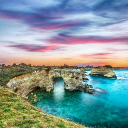 Dramatic seascape with cliffs, rocky arch at Torre Sant Andrea, Salento coast, Puglia region, Italy