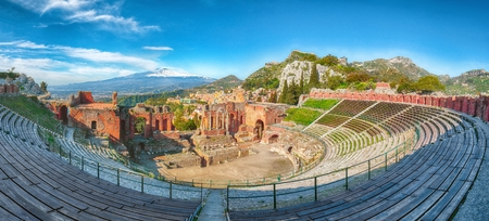 Ruins of ancient Greek theater in Taormina and Etna volcano in the background. Coast of Giardini-Naxos bay, Sicily, Italy, Europe. Reklamní fotografie