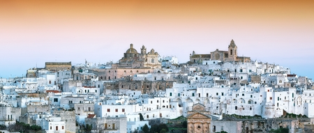 Ostuni white town skyline at sunrise. Brindisi, Apulia southern Italy. Europe.