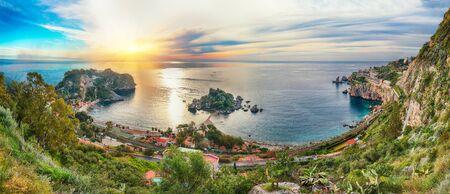 Panoramic aerial view of Isola Bella island and beach in Taormina. Giardini-Naxos bay, Ionian sea coast, Taormina, Sicily, Italy.