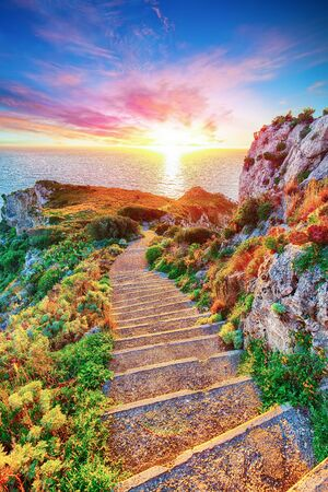 Dramatic spring sunset on the the cape Milazzo panorama of nature reserve Piscina di Venere. Location: cape Milazzo, Island Sicilia, Italy, Europe. Mediterranean and Tyrrhenian sea Banque d'images