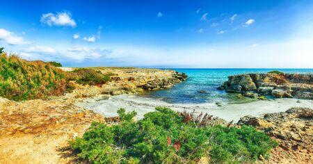 Picturesque seascape with white rocky cliffs, sea bay, islets and faraglioni near by Conca Specchiulla Beach, Salento Adriatic sea coast, Puglia, Italy